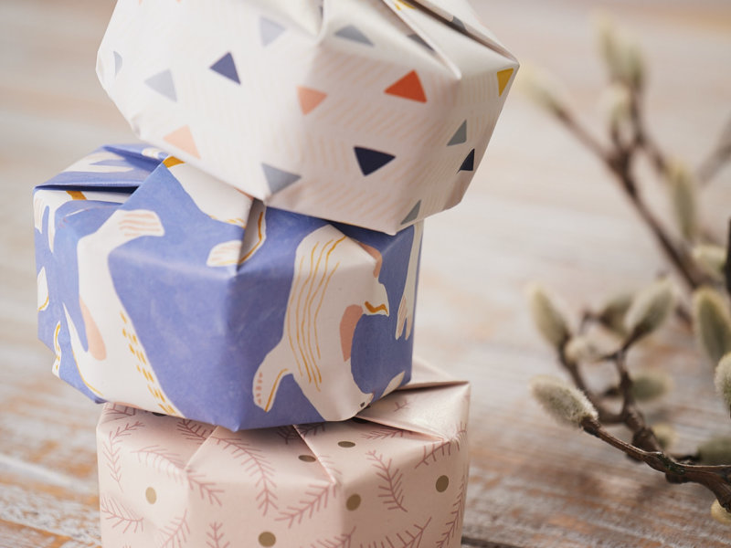 3 piled gifts with Impression Originale recycled and original design gift wraps