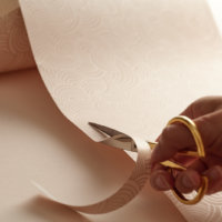 Home Impression Originale cutting gift wrap with golden cissors