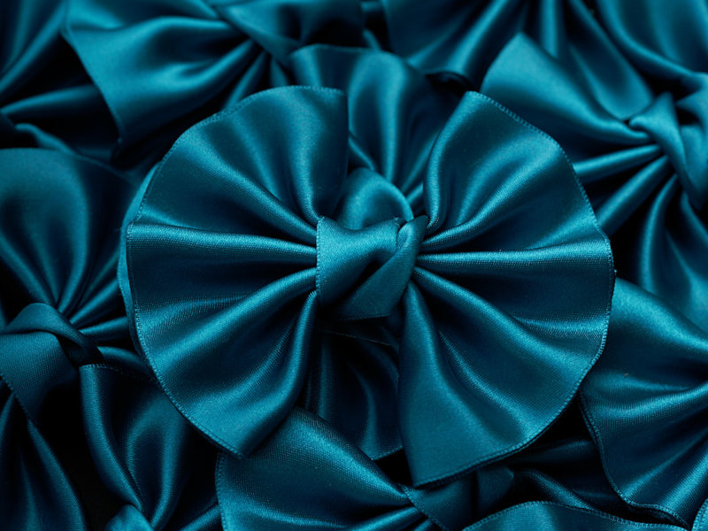 Home Impression Originale teal satin bow winged on stack of bows